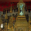 The Emerald Buddha was carved from green jade and adorned with gold. Found in 1434 covered in plaster and later stolen by Laos it was recovered and returned to Thailand in 1785 and placed here in the Royal Chapel.